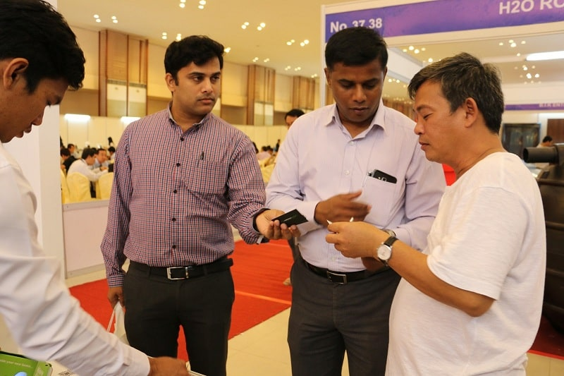 Business owners network at a Cambodia event